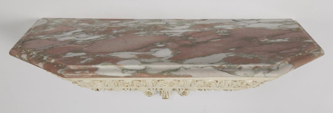 "Carved marble top paint-decorated wall bracket, 28""l - 3"