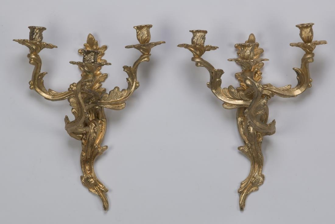 Pair of Louis XV style gilt bronze 3-arm sconces