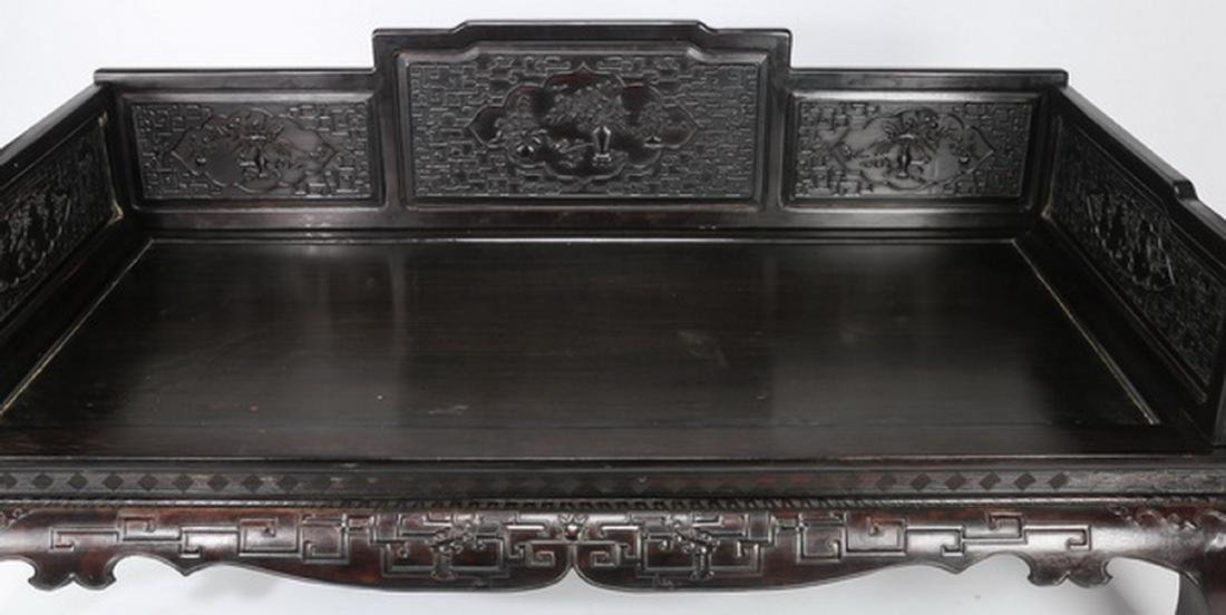 "Chinese carved and ebonized daybed, 78""l - 8"
