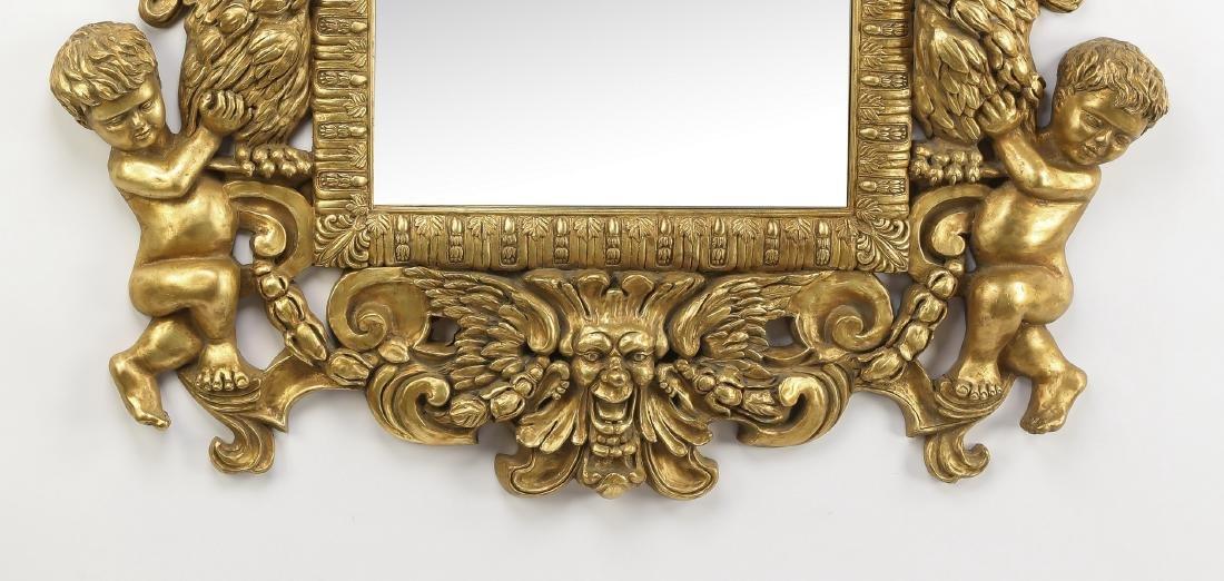 "Baroque inspired gilt figural mirror, 47""h - 3"