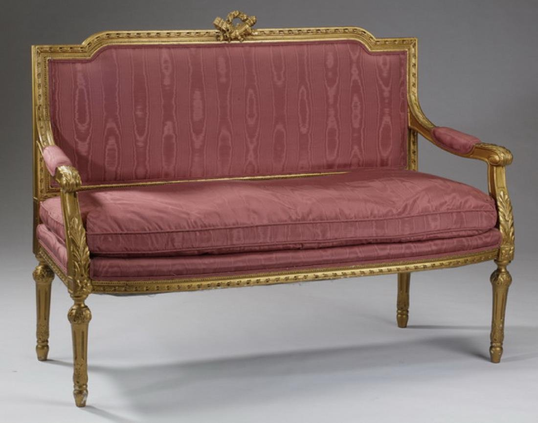 """Gilt wood settee in rose satin fabric, 56""""l"""