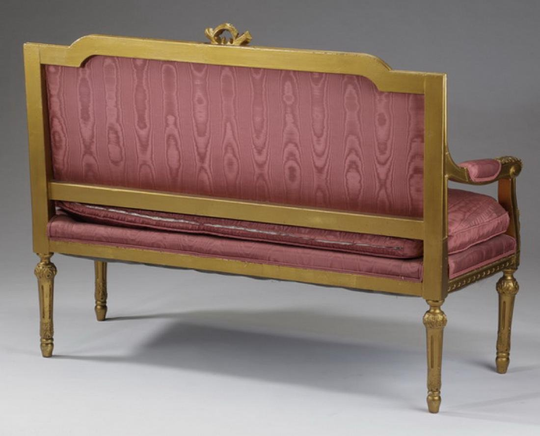 "Gilt wood settee in rose satin fabric, 56""l - 2"