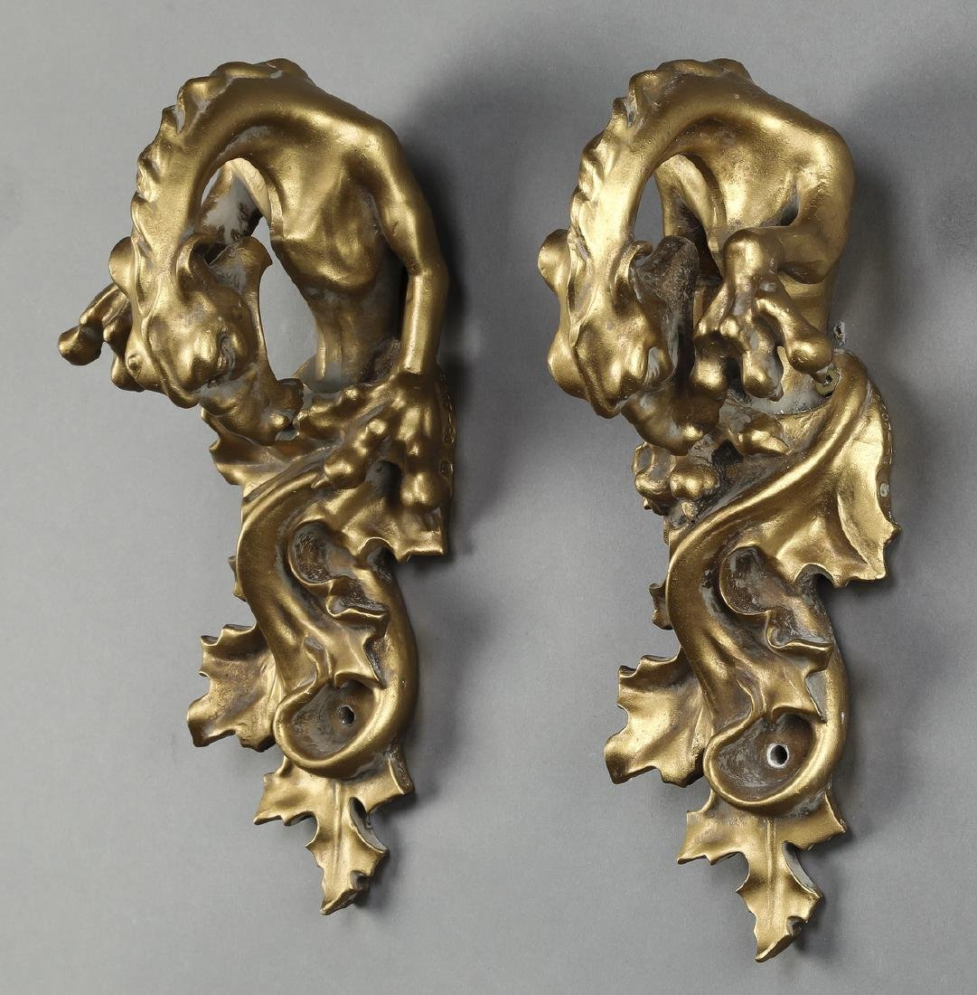 "Pair of carved and gilt dragon tiebacks, 12""h"