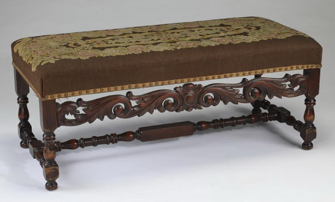 19th c. carved bench upholstered in needlepoint