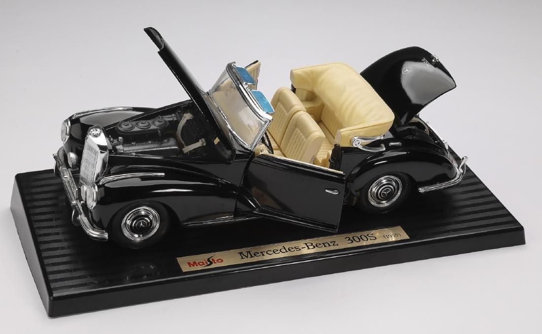 """Maisto 1955 black Mercedes-Benz 300S on stand, 4""""h"""