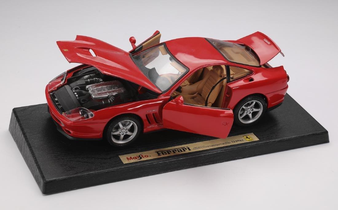 "Maisto 1996 red Ferrari 550 Maranello on stand, 4""h"