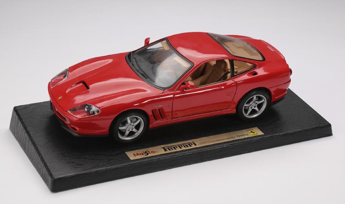 "Maisto 1996 red Ferrari 550 Maranello on stand, 4""h - 2"