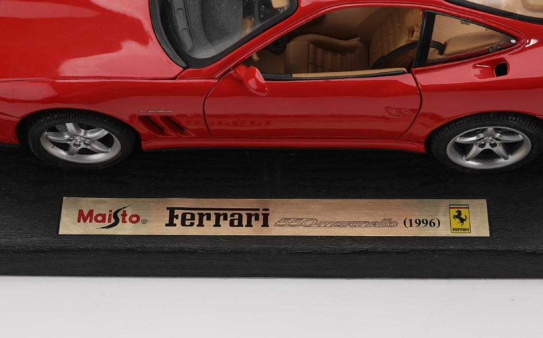 "Maisto 1996 red Ferrari 550 Maranello on stand, 4""h - 3"