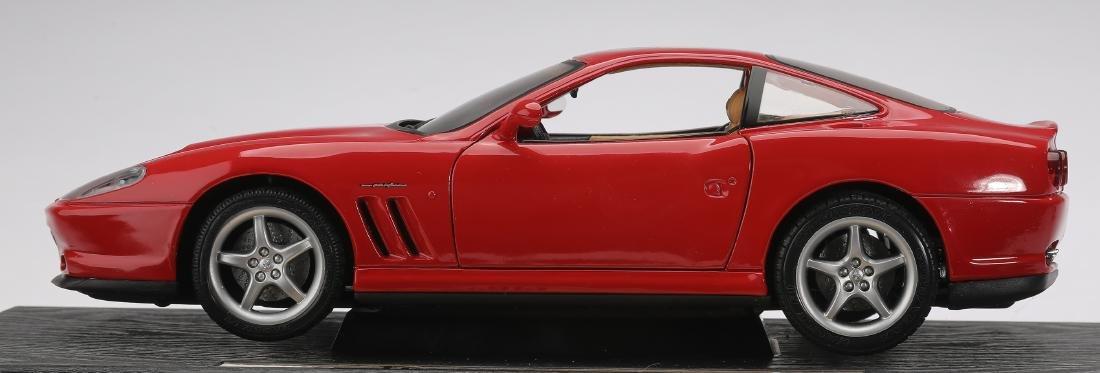 "Maisto 1996 red Ferrari 550 Maranello on stand, 4""h - 4"