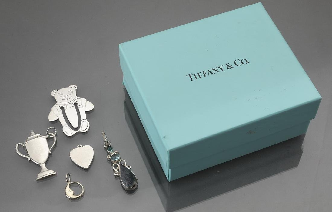 (5) Sterling items, including Tiffany & Co. charms