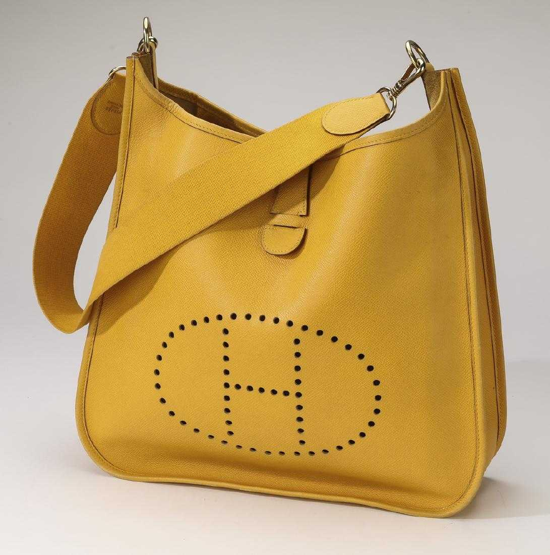 33ee64fcab5 Hermes  Evelyne  yellow leather shoulder bag
