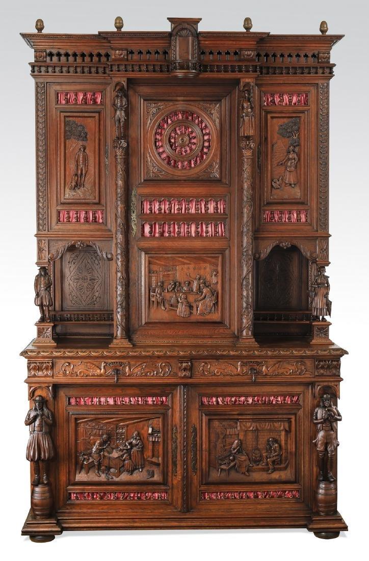 Monumental 19th c. Breton carved oak figural cabinet