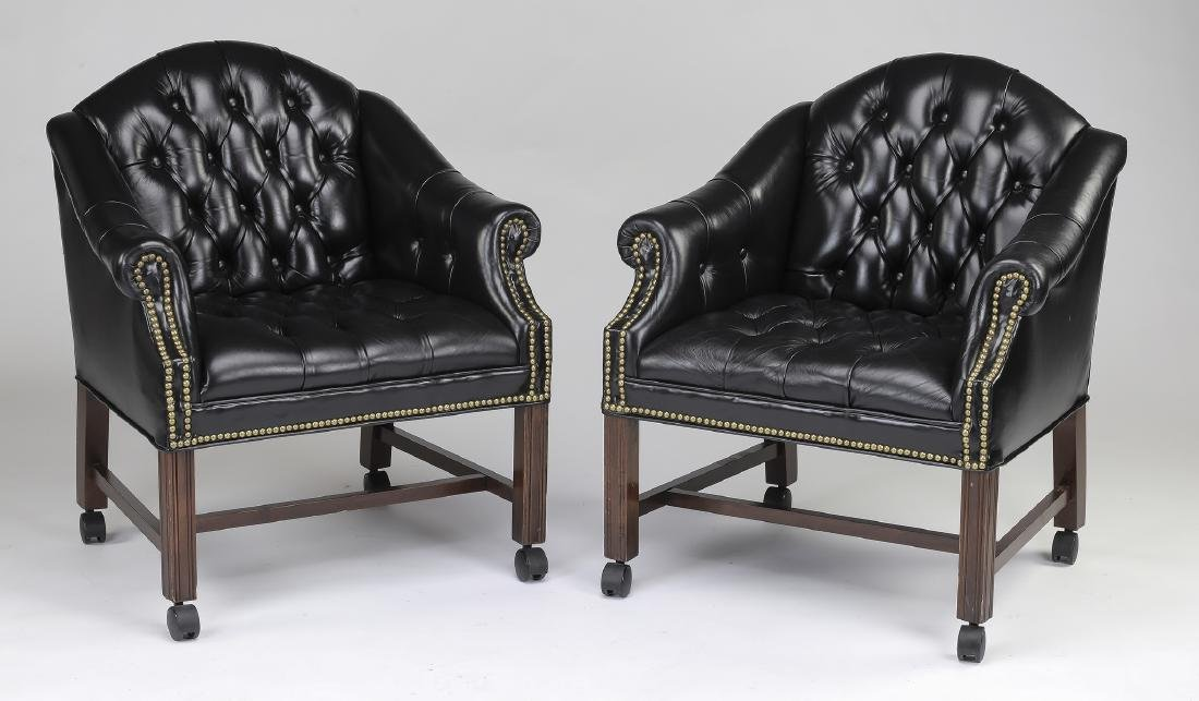 (2) Button-tufted leather club chairs on casters