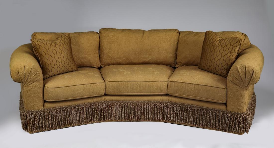 Wesley Hall curving sofa with bullion fringe skirt