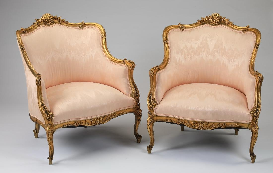 (2) Louis XV style gilt wood bergeres in peach moire'