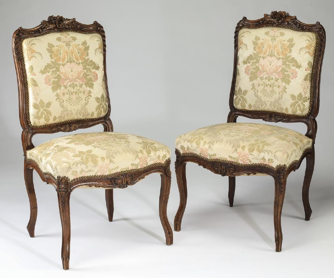 (2) 19th c. French walnut side chairs in damask