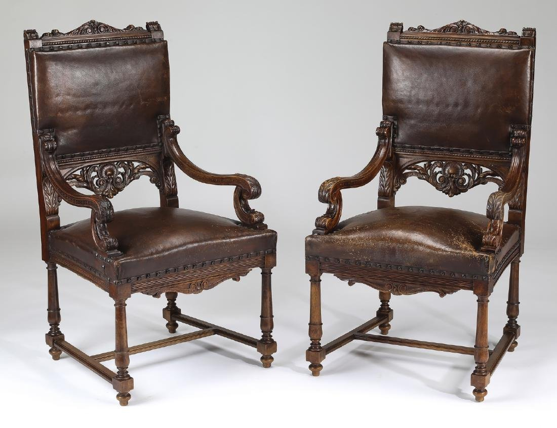 (2) 19th c. carved Italian armchairs in leather