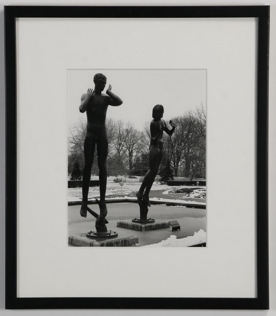 Framed photograph of sculptures in a park