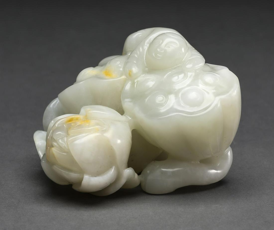 Chinese celadon jade boy atop lotus buds
