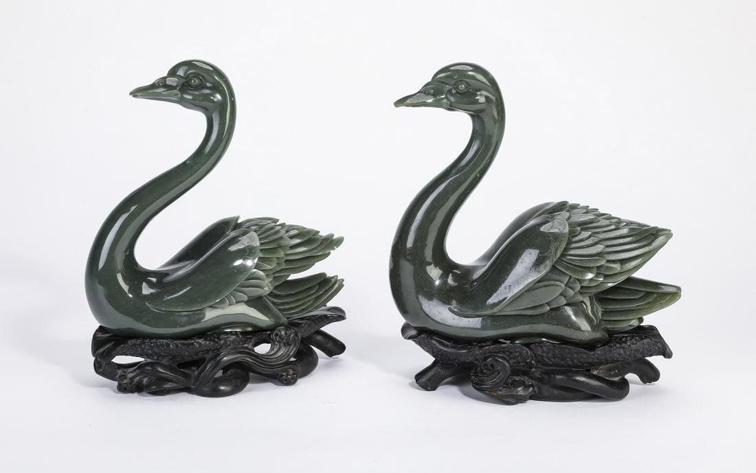 "(2) Chinese carved spinach jade swans on stands, 7""h"