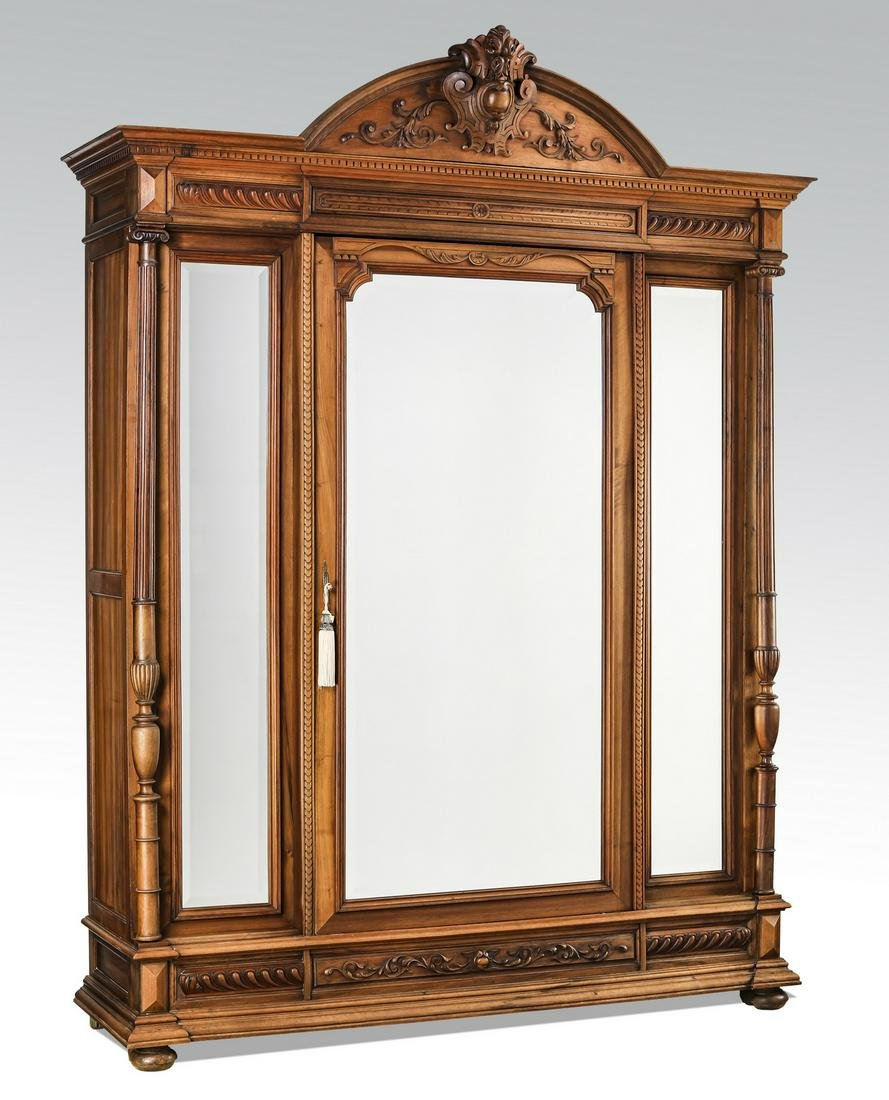 19th c. French carved walnut triple door armoire