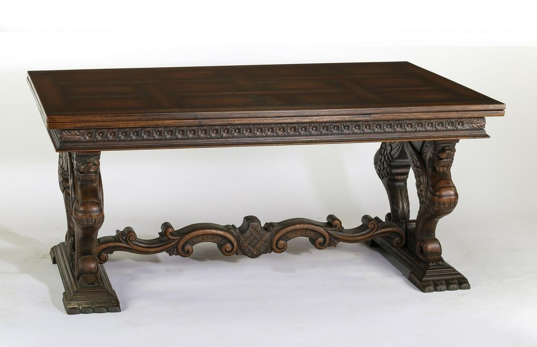 19th c. French oak draw leaf table with griffins