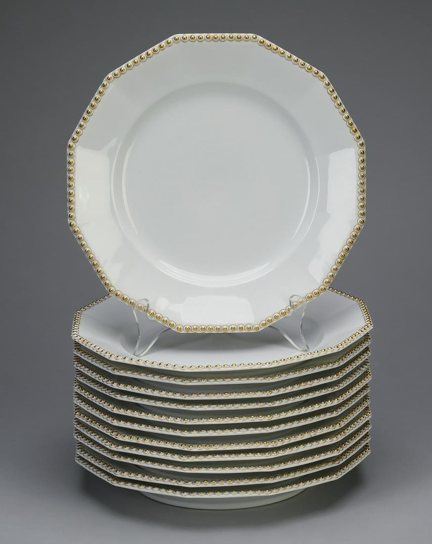 (12) Nymphenburg 'Pearl Gold' dinner plates