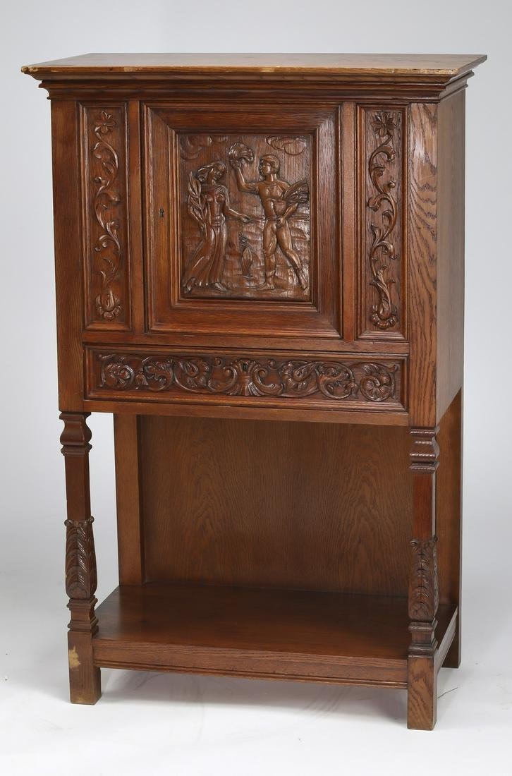 Early 20th c. carved oak court cupboard