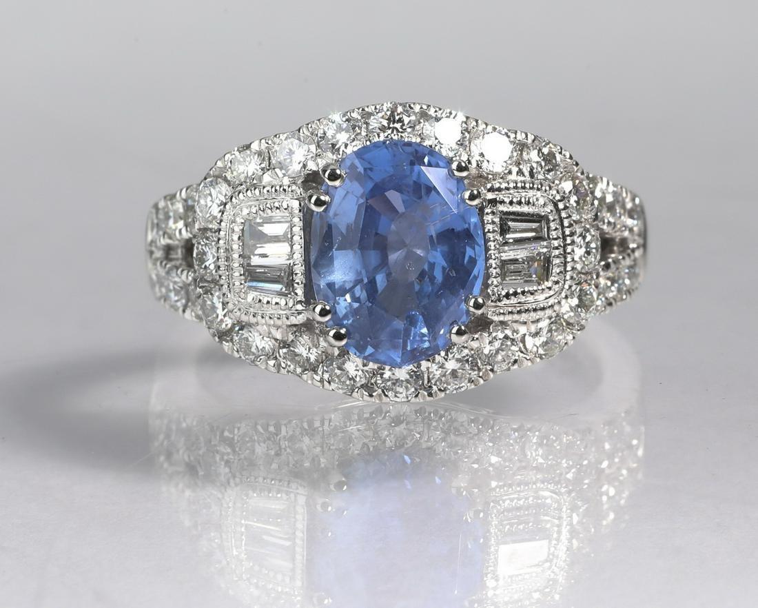 Blue sapphire, diamond, and platinum ring
