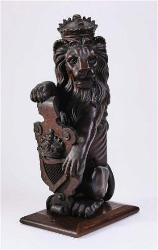 Carved oak architectural element, lion with shield