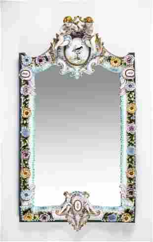 Italian porcelain wall mirror with putti and florals