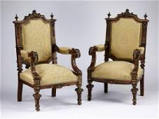 (2) 19th c. parcel gilt walnut armchairs in silk