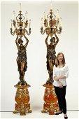 (2) Oversize figural bronze maiden torchieres
