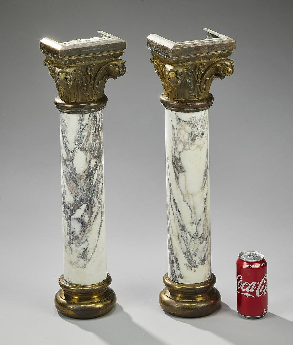 "(2) Continental carved marble and bronze columns 23""h"