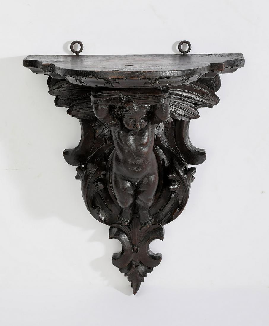 Late 19th c. carved walnut putto figural bracket