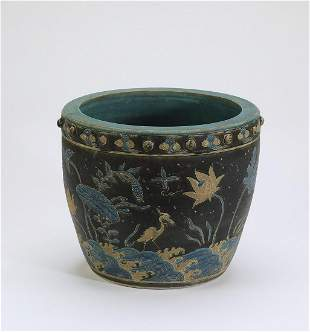 Chinese Ming style famille noire Fahua vase
