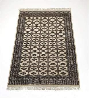 Hand knotted wool Pakistani Bokhara rug, 9 x 6