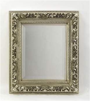 Silver gilt mirror with highly sculpted foliage