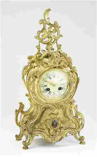 "French Rococo Revival clock by L. Marti, 18""h"