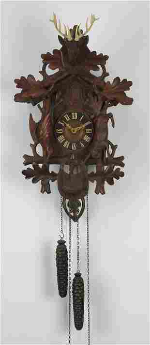 Early 20th c. Black Forest hunter's cuckoo clock