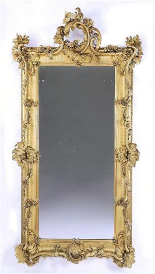 Monumental 19th c. Rococo Revival gilt wood mirror