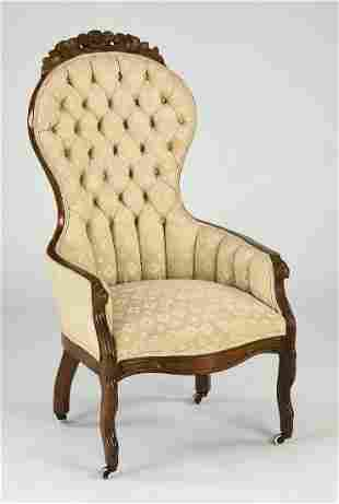 Victorian walnut tufted chair on casters