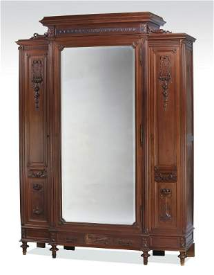 19th c. French walnut armoire with floral carvings
