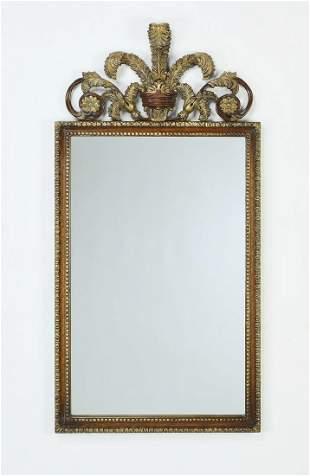 Parcel gilt carved mahogany wall mirror