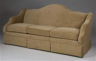 Custom designed three seat camel-back sofa