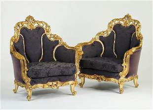 (2) Extravagant Italian carved giltwood bergeres