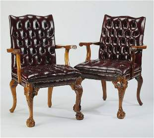 (2) Leather upholstered Chippendale style armchairs