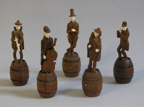 253: 19th century carved walnut and ivory minstrels