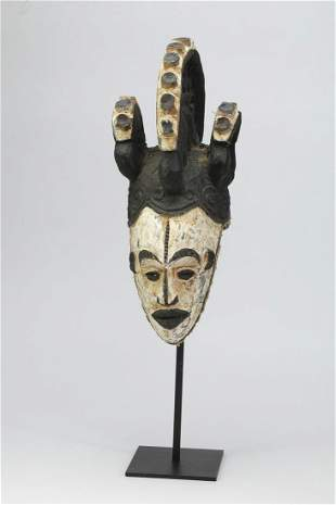 Igbo maiden spirit helmet mask, Nigeria, mid 20th c.