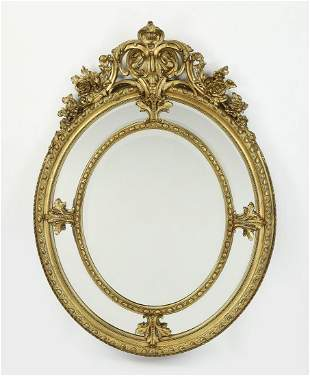 Early 20th c. French giltwood beveled oval mirror